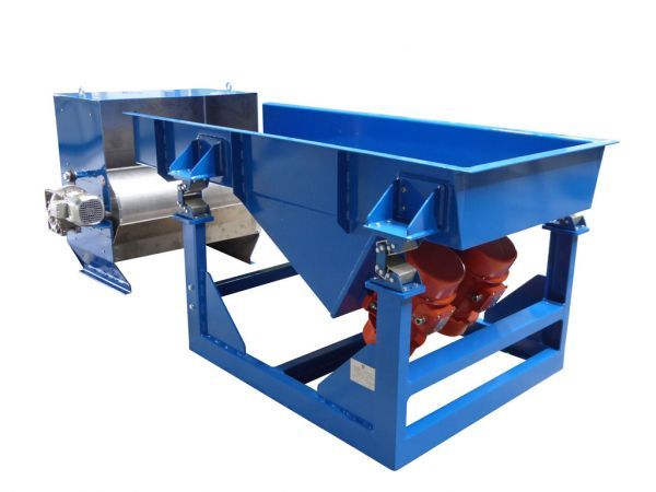 Vibrating feeder with magnetic drum